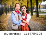 bavarin germans in dirndl and... | Shutterstock . vector #1164754105