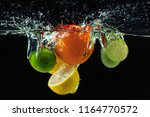 many fruits splashes into water | Shutterstock . vector #1164770572