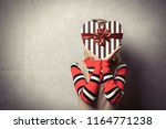 young girl with heart shape... | Shutterstock . vector #1164771238