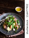 Summer potato salad with fresh vibrant greens and dressing. styled by food stylist - stock photo