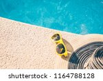 sunglasses and hat on the... | Shutterstock . vector #1164788128