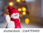Closeup Toy Cute Snowman In Ha...