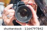 female photographer outdoor. | Shutterstock . vector #1164797842