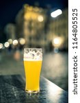 glass of beer on  table by night | Shutterstock . vector #1164805525