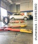 motion blurred background tire... | Shutterstock . vector #1164813802