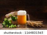 mug of beer with green hops and ... | Shutterstock . vector #1164831565