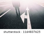 business man stands alone on... | Shutterstock . vector #1164837625
