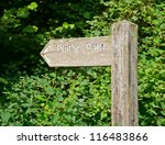 Weathered wooden sign post pointing to Public Path - stock photo