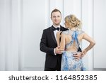 young couple in luxury... | Shutterstock . vector #1164852385