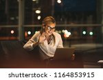 woman on video call using a... | Shutterstock . vector #1164853915