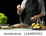 cooking the chief of fresh fish ... | Shutterstock . vector #1164855532