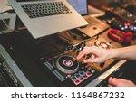 overhead shot of dj controling... | Shutterstock . vector #1164867232
