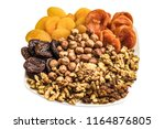 Nuts And Dried Fruits On A...