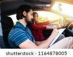driving school or test.... | Shutterstock . vector #1164878005