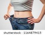 closeup of slim waist of young... | Shutterstock . vector #1164879415