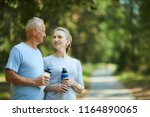 affectionate senior couple with ... | Shutterstock . vector #1164890065
