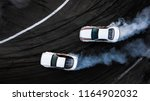 aerial top view two cars drift... | Shutterstock . vector #1164902032