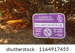 a purple sign advises of use of ... | Shutterstock . vector #1164917455