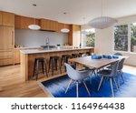 mid century modern kitchen... | Shutterstock . vector #1164964438