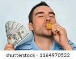 a man with a gold coin and... | Shutterstock . vector #1164970522