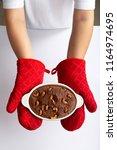 woman wearing red gloves... | Shutterstock . vector #1164974695