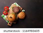tasty grilled home made burgers ... | Shutterstock . vector #1164983605
