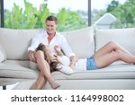 portrait of nice young couple... | Shutterstock . vector #1164998002
