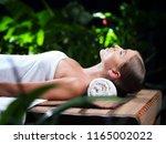 portrait of young beautiful... | Shutterstock . vector #1165002022