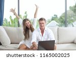 portrait of nice young couple... | Shutterstock . vector #1165002025