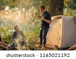 two guys are talking camp... | Shutterstock . vector #1165021192