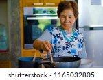 lifestyle portrait of senior... | Shutterstock . vector #1165032805