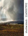 old faithful geyser erupting ...   Shutterstock . vector #1165037992