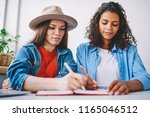 clever hipster girls doing... | Shutterstock . vector #1165046512