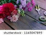 table florist. flowers  pruner  ... | Shutterstock . vector #1165047895