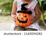 happy little asian girl in...   Shutterstock . vector #1165054282