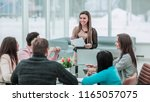 manager conducts the... | Shutterstock . vector #1165057075