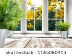 wooden table of free space for... | Shutterstock . vector #1165080415