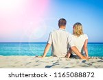 pregnant couple in love on the... | Shutterstock . vector #1165088872