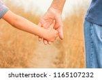 beautiful hands of a happy... | Shutterstock . vector #1165107232