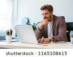 portrait of focused young... | Shutterstock . vector #1165108615