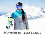photo of smile woman in helmet... | Shutterstock . vector #1165123072