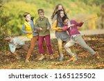 happy autumn children   | Shutterstock . vector #1165125502