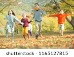 happy autumn children   | Shutterstock . vector #1165127815