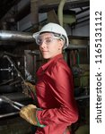 woman as metalworker wearing... | Shutterstock . vector #1165131112