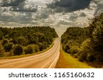 the road to the horizon. green... | Shutterstock . vector #1165160632