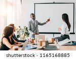 multicultural business people... | Shutterstock . vector #1165168885
