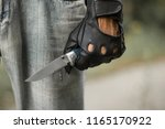 Man Hand In Black Glove With...