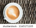 close up white cup of latte art ... | Shutterstock . vector #1165171105