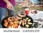 young woman cooking meat and... | Shutterstock . vector #1165201255