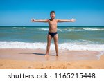 adorable boy standing on the... | Shutterstock . vector #1165215448